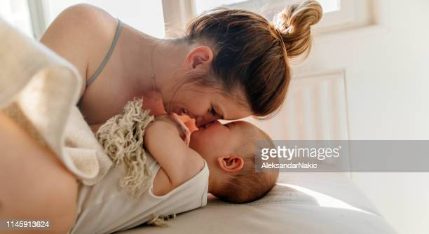 cuddle - mother stock pictures, royalty-free photos & images