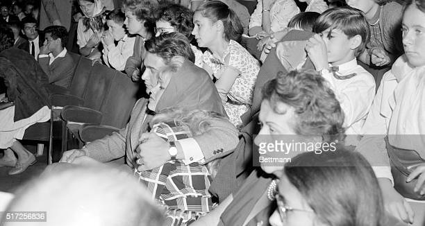 Cuddled tenderly by her husband actor Jacques Charrier actress Brigitte Bardot attends a special showing of the film Babette goes to war at the...