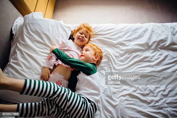 Cuddles in Mum's Bed