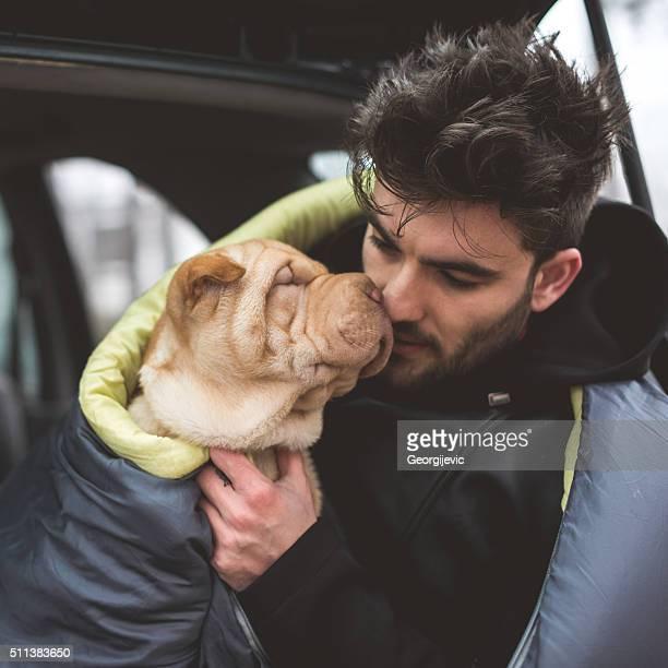 Cuddling a dog
