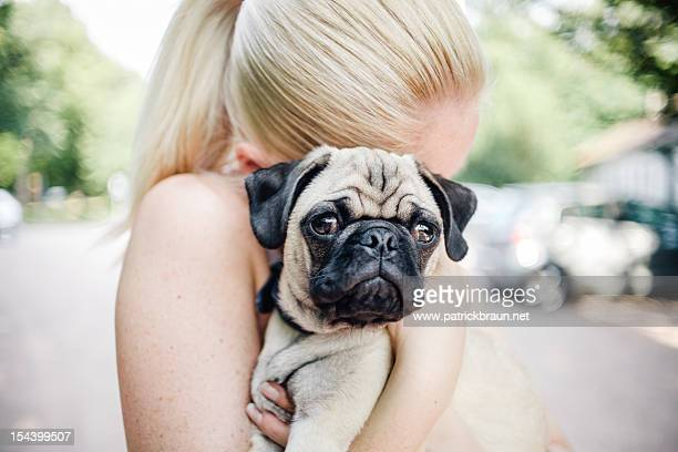 cuddling a pug