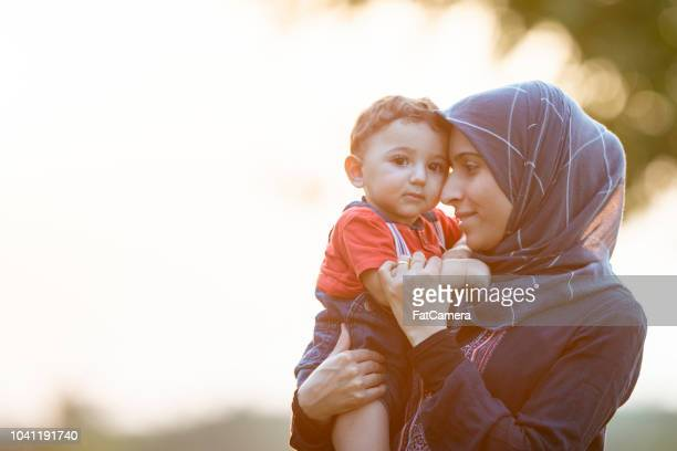 cuddling toddler - middle east stock pictures, royalty-free photos & images