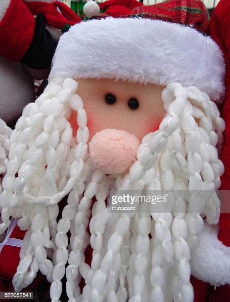 cuddly toy cartoon santa claus / father christmas, dreadlocks white-beard, winter-display - cartoon santa claus stock photos and pictures