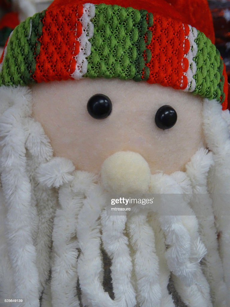 Cuddly toy cartoon Santa Claus / Father Christmas, dreadlocks white-beard, : Stock Photo