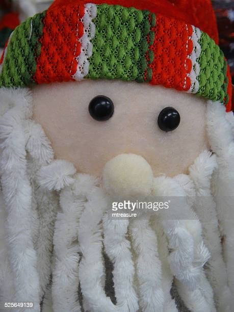 cuddly toy cartoon santa claus / father christmas, dreadlocks white-beard, - cartoon santa claus stock photos and pictures