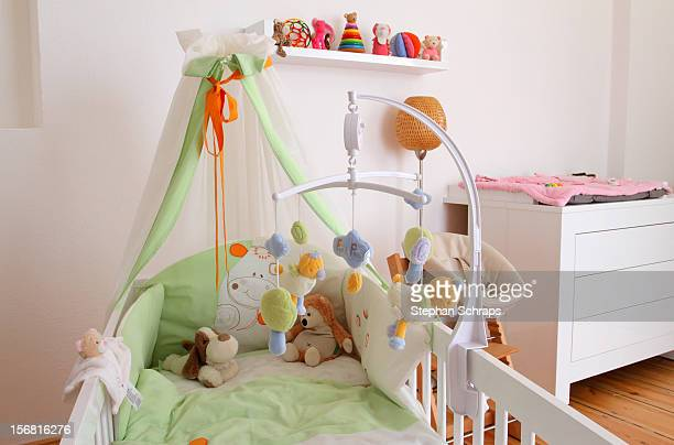 Cuddly toys lay on a baby crib during a photo session with Rocco Stark and his pregnant girlfriend Kim Gloss at their appartment on November 08 2012...
