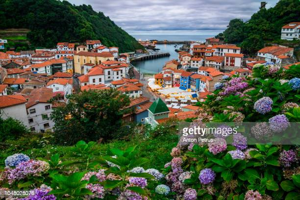 cudillero, picturesque fishing village at sunset, asturias, spain - spain stock pictures, royalty-free photos & images