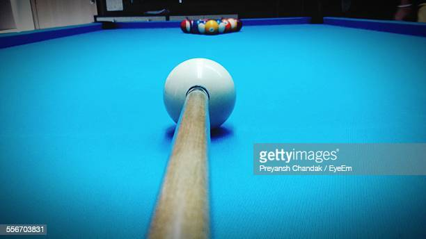 Cue And Balls On Blue Pool Table