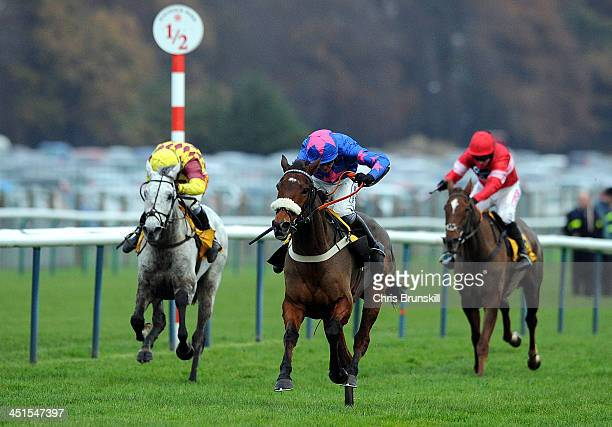 Cue Card ridden by Joe Tizzard races clear to win The Betfair Steeple Chase held at Haydock Racecourse on November 23 2013 in Haydock England
