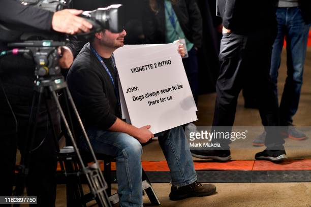 A cue card states Dogs always seem to be there for us' for host John O'Hurley to read as an introduction during the National Dog Show held at the...