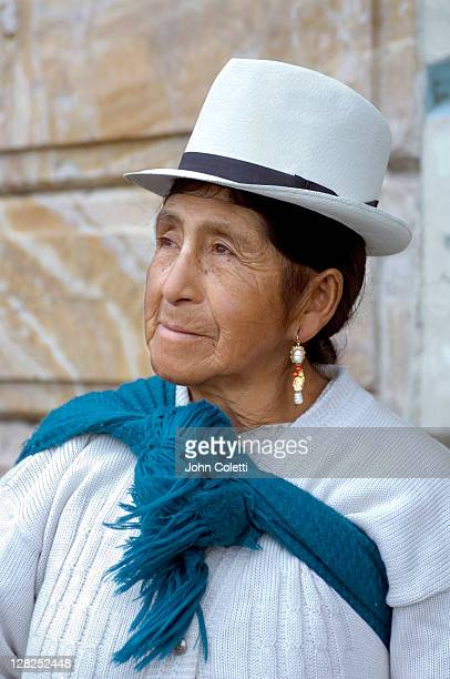 Cuenca / Ecuador / Panama hat and shawl distingushes this indigenous woman's ethnicity and traditions