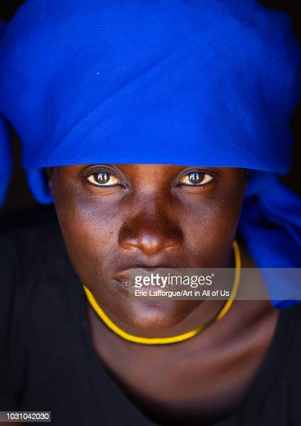 Cuepe tribe woman with a blue headwear Cunene Province Curoca Angola on July 18 2018 in Curoca Angola