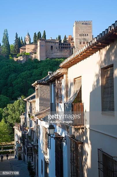 Cuesta de la Victoria street in the Albaicin district Granada Spain view over to the Alhambra
