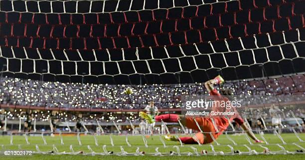 Cueva of Sao Paulo scores their first goal during the match between Sao Paulo and Corinthians for the Brazilian Series A 2016 at Mrumbi stadium on...