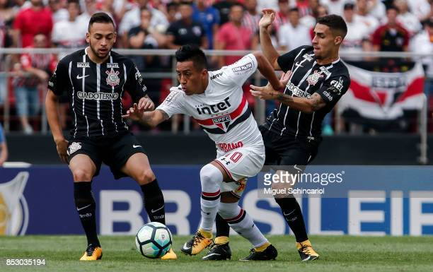 Cueva of Sao Paulo vies the ball with Maycon and Gabriel of Corinthians during the match between Sao Paulo and Corinthians for the Brasileirao Series...