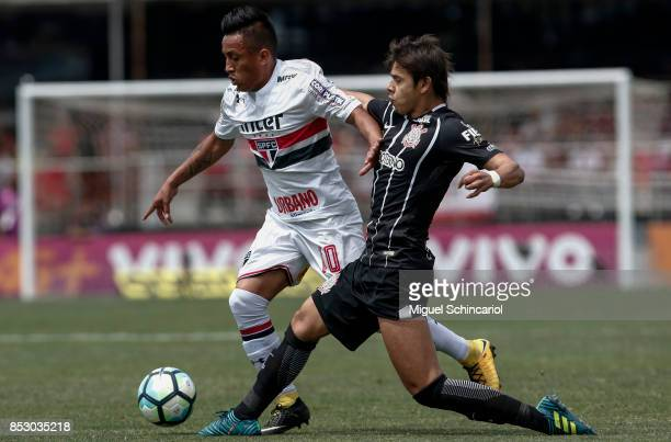 Cueva of Sao Paulo vies the ball with Romero of Corinthians during the match between Sao Paulo and Corinthians for the Brasileirao Series A 2017 at...