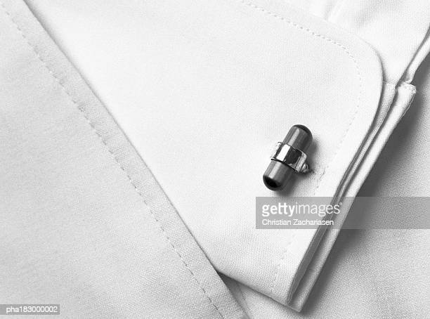 Cufflink, close-up, b&w