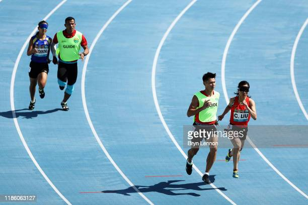 Cuiqing Liu of China and her guide Donglin Xu compete in round 1/heat 3 of the Women's 400m T11 during Day One of the IPC World Para Athletics...