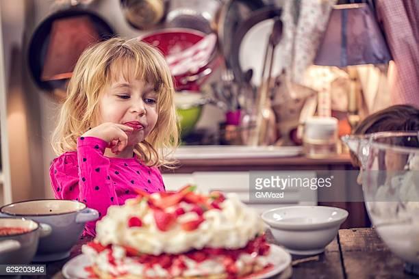 Cule Kids Eating Berry Pavlova Cake with Strawberries and Raspberries