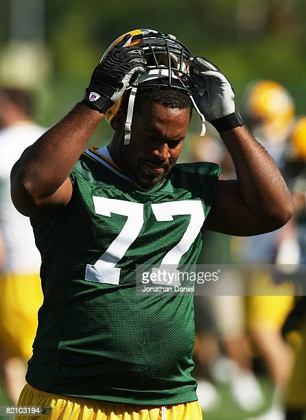 Cullen Jenkins of the Green Bay Packers takes off his helmet during a summer training camp practice on July 28 2008 at the Hutson Center in Green Bay...