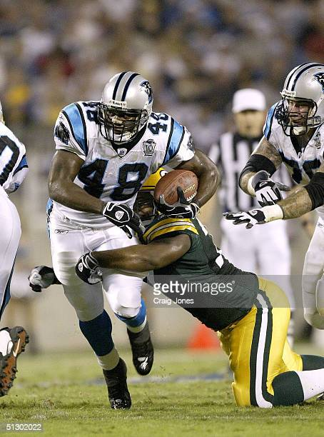 Cullen Jenkins of the Green Bay Packers tries to stop running back Stephen Davis of the Carolina Panthers on September 13 2004 at Bank of America...