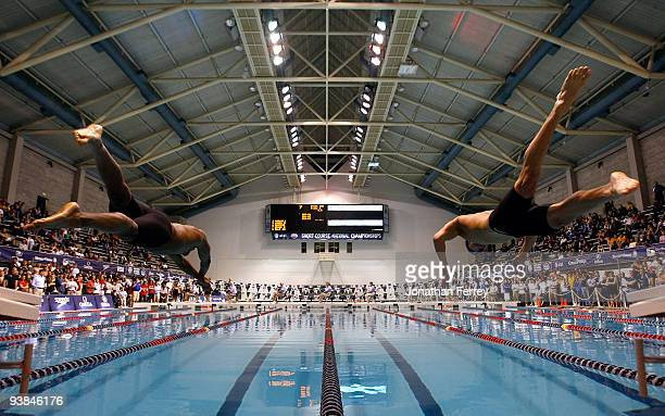 Cullen Jones and Nathan Adrian dive off the blocks at the start of the 50 yard freestyle final during day one of the ATT Short Course Nationals at...