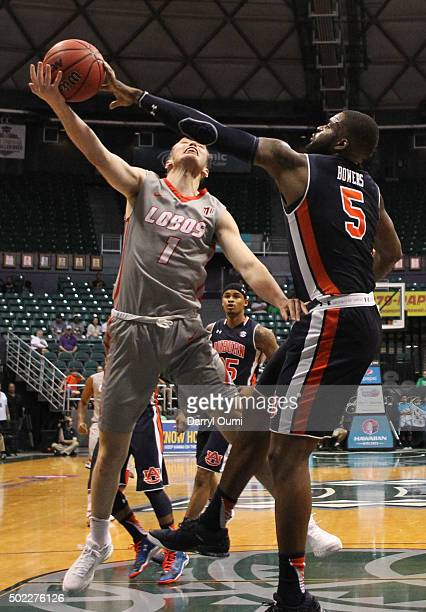 Cullen Neal of the New Mexico Lobos has his shot blocked by Cinmeon Bowers of the Auburn Tigers at the Stan Sheriff Center during the Diamond Head...