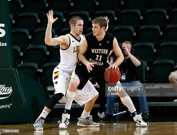 Cully Payne of the Loyola-Chicago Rambers defends against Nate Hutcheson of the Western Michigan Broncos during the game at the Sun Dome on November...