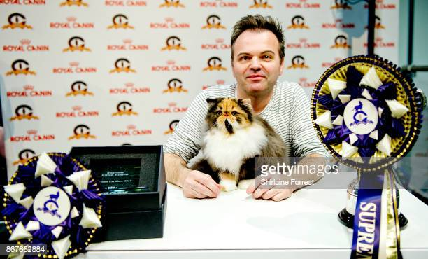 CullyKhan Bellini a Tortie and White Persian kitten and runner up for Best In Show participates in the GCCF Supreme Cat Show at National Exhibition...