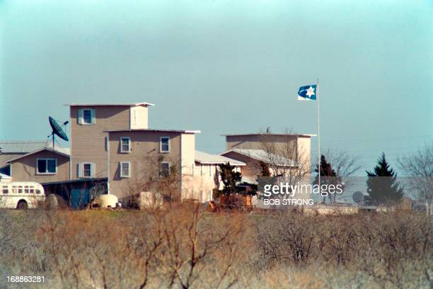 Cult flag flies over the Branch Davidian compound in Waco on March 08, 1993 . After a shootout in Waco in 1993 that killed four federal agents and...