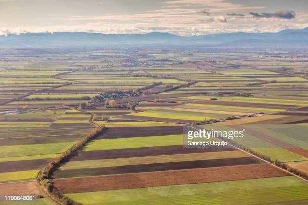 cultivated land and villages around vienna - 休耕田 ストックフォトと画像