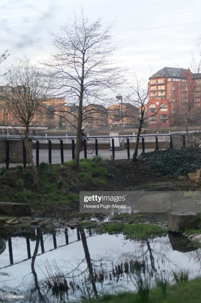 Cultivated Spring Landscapes and Riverbank Architecture : Stock-Foto