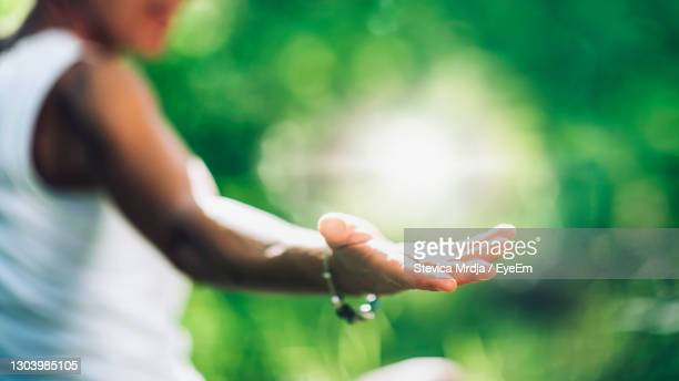 cultivating a positive self-healing energy. open female hand, playing with light - one mature woman only stock pictures, royalty-free photos & images