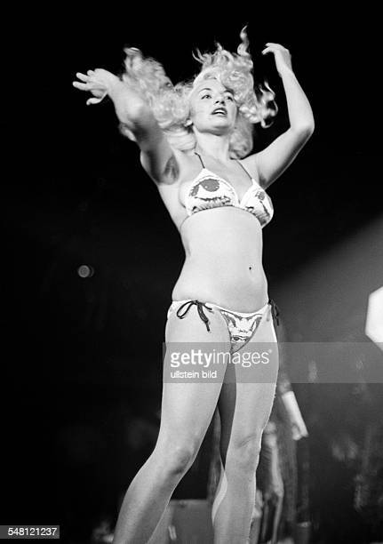 cultural event 1979 in the Westphalia Hall in Dortmund Bild Disco discotheque organized by the Bild Zeitung seminude girl dancing girl in a bikini...