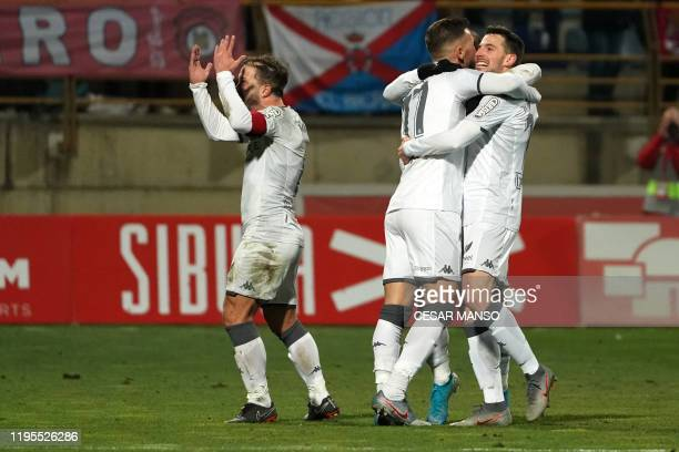 Cultural Leonesa's Julen Castaneda celebrates with teammates after scoring a goal during the Copa del Rey football match between Cultural Leonesa and...