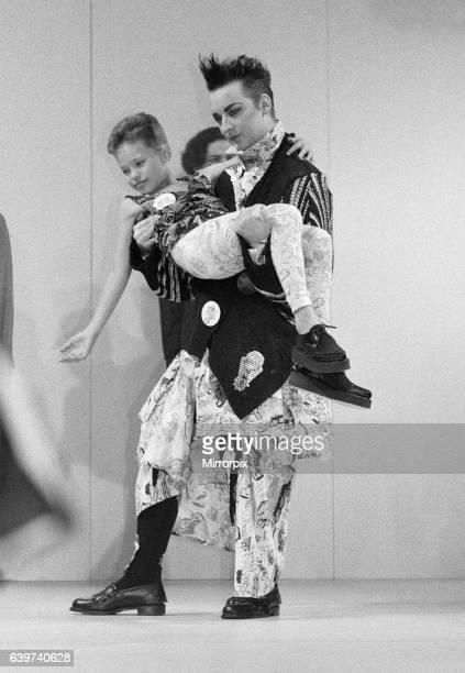 Culture Club singer Boy George modelling clothes on the catwalk at the Bodymap Fashion Show at the Duke of York barracks in Chelsea 11th October 1985