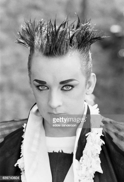 Culture Club singer Boy George poses outdoors in the garden August 1985