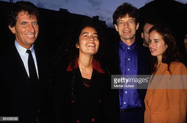 Culture Minister Jack Lang musician Mick Jagger of The Rolling Stones and his daughters Karis and Jade are seen in 1995 in Paris France