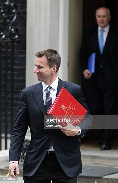 Culture, Olympics, Media and Sport Secretary Jeremy Hunt leaves following the first cabinet meeting of the new coalition government at Downing Street...