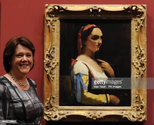 Culture Secretary Maria Miller unveils the Jean Baptiste Corot painting ' L'Italienne ou La Femme a la Manche Jaune' at the National Gallery. The...