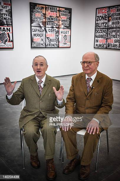 STORY CultureBritainHongKongartpeopleGilbertGeorgeINTERVIEW by Stephen COATES Gilbert and George sit in front of their latest artwork at the White...