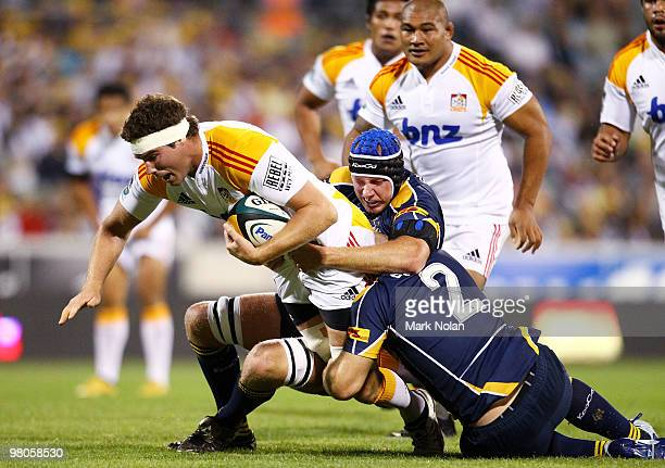 Culum Retallick of the Chiefs is tackled during the round seven Super 14 match between the Brumbies and the Chiefs at Canberra Stadium on March 26,...