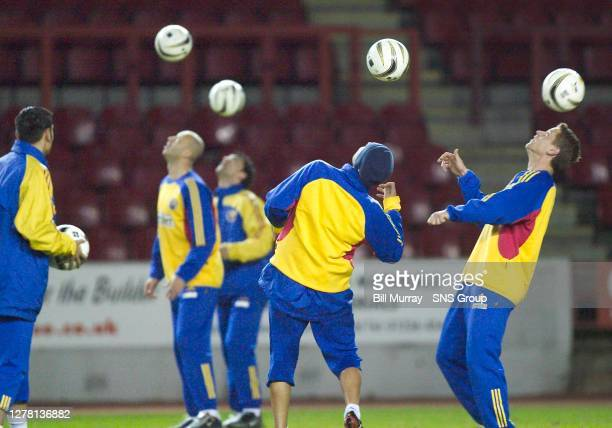 The Romania squad indulge in some heading practice at training.