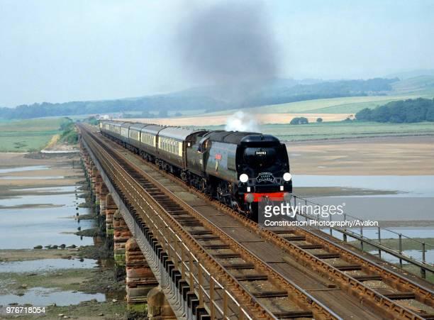 Cumbrian Coast Express No 34092 City Of Wells crosses Eskmeals Viaduct on the return trip from Sellafield to Carnforth United Kingdom