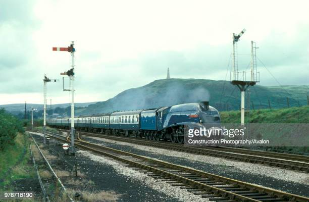 Cumbrian Coast Express Sir Nigel Gresley brings a train into Ulverston United Kingdom