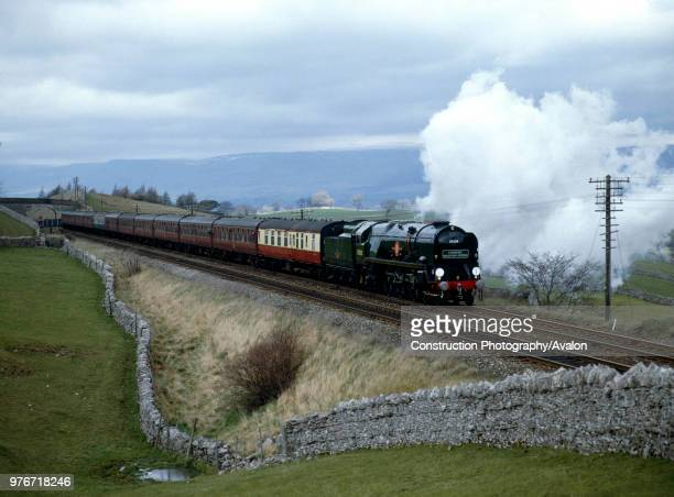 Cumbrian Mountain Express No 35028 Clan Line leaves Kirby Stephen across Birkett Common on route from Carlisle to Hellifield United Kingdom