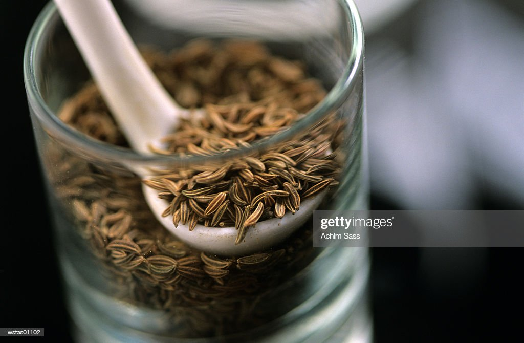 Cumin seeds in jar : Foto de stock