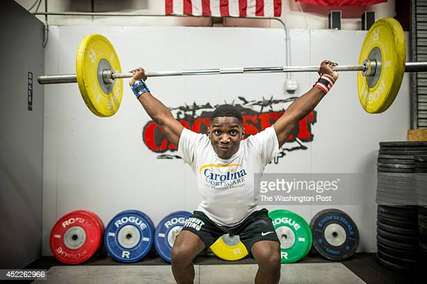 Cummings practices his snatch clean and jerk at Cross Fit Beaufort while training with weightlifting coach Ray Jones on July 14 2014 in Beaufort...