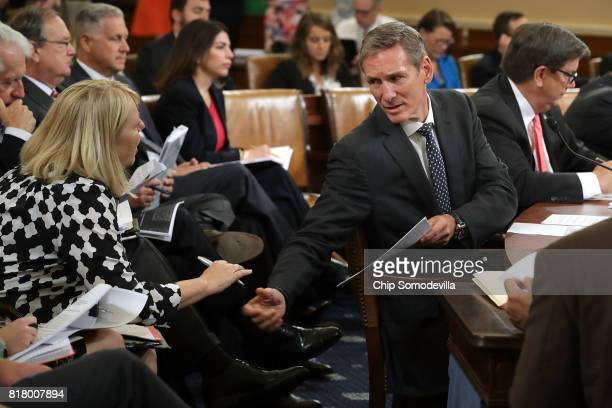 Cummins Chairman and CEO Tom Linebarger consults with an aide while testifying before the House Ways and Means Committee's Trade Subcommittee about...