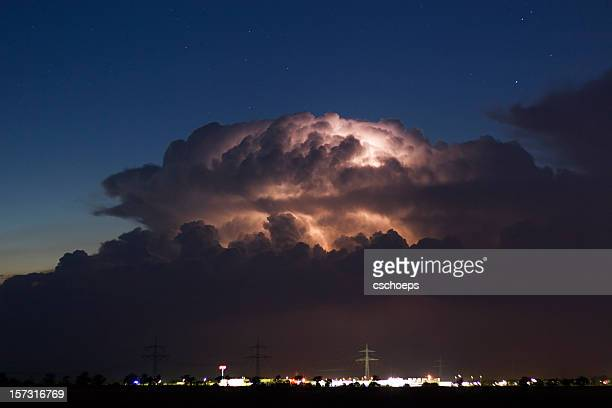 cumulonimbus at night - storm season tornadoes stock photos and pictures